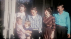 Family members gather for photos at grandma's house 3740 vintage film home movie Stock Footage