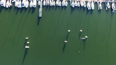 People sailing dinghies near a marina. Stock Footage