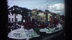 1962: floats going by at the local parade. PASADENA CALIFORNIA Stock Footage