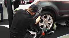 Man pasting the car with Oracal Carbon film Stock Footage