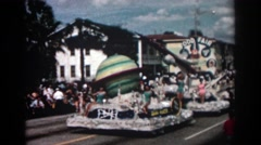 1962: pageant queens atop a food fair float featuring a space theme Stock Footage