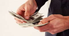 Mid-section of man counting hundred dollar note Stock Footage