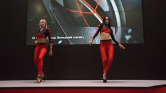 Showgirl dancers dancing on exhibition IgroMir Expo 2016 and Comic Con Russia Stock Footage