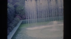 1966: water fountain shooting high into the pool with grotto FLORIDA Stock Footage