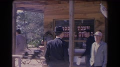 1966: townsfolk milling about in front of the ghost town general store FLORIDAD Stock Footage
