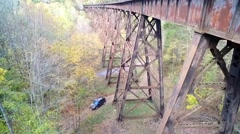 Crane Shot of Railroad Trestle in Autumn Appalachia Stock Footage