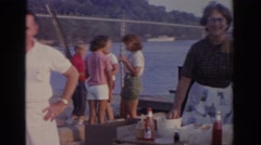 1963: family and friends barbecuing on a pier NEW JERSEY Stock Footage