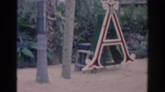 1966: a man tending to his exotic birds at a sanctuary FLORIDA Stock Footage