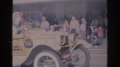 1966: an old-timey car doing wheelies at a parade FLORIDA Stock Footage