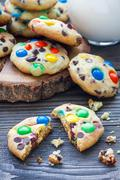 Shortbread cookies with multi-colored candy and chocolate chips on wooden boa Stock Photos