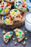 Shortbread cookies with multi-colored candy and chocolate chips on wooden tab Stock Photos