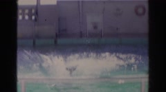 1966: a funny dolphin is jumping into the water watched by people NORFOLK Stock Footage
