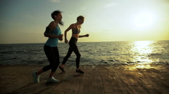 Two active friends training sport near the sea Stock Footage
