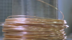 Gold wire in coil. golden thread Stock Footage