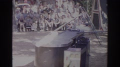 1966: pair of performing cockatoos and their handler at a zoo amphitheater Stock Footage