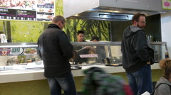 People buying food at food court area inside Coquitlam shopping mall Stock Footage