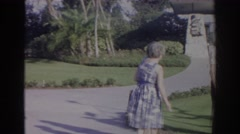 1966: people walking through parking lot, conversing with each other on holiday Stock Footage