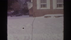 1966: the premises of a house with snow covering on the yard NORFOLK VIRGINIA Stock Footage