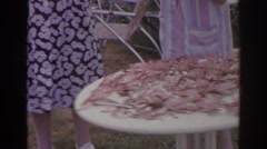 1966: two women preparing a table full of fresh crabs outside NORFOLK VIRGINIA Stock Footage