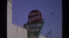 1966: sightseeing random advertising signs. SAN GABRIEL CALIFORNIA Stock Footage