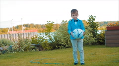 Boy Playing in Garden Among Beautiful Flower Beds Stock Footage