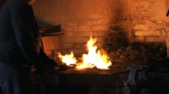 Metal forging, Forging hot metal in smithy, Sparks, hard work Stock Footage