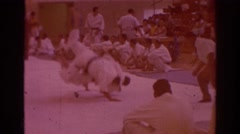 1966: two men compete at a karate match in a gymnasium TEMPLE CITY CALIFORNIA Stock Footage