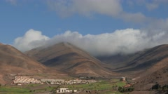 4K Fast moving clouds over mountains in Fuerteventura 400% speed Stock Footage