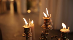 Candle in a candlestick a warm atmosphere, background Stock Footage