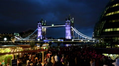 Music festival next to Tower Bridge and City hall on a summer night. Stock Footage