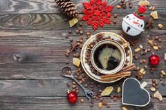 Rustic wooden background with cup of coffee and New Year decorations. Heart s Stock Photos