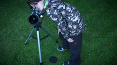 4k Technology and Astrology Child with Telescope Exploring Stars and Sky Stock Footage