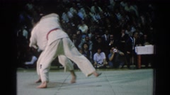 1966: an eastern-style wrestling match takes place before a large audience  Stock Footage