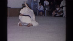 1966: two judo players in white uniform performing before a small group SAN Stock Footage
