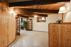 Wooden house interior with round wall , ceiling with wooden beams and carpet  Stock Photos