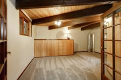 Wooden house interior with carpet floor and ceiling with wooden beams Northwe Stock Photos