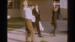 1966: group of men happily celebrating a win with their families  Stock Footage