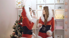 Sexy girls dressed in santa suit dancing indoor in 4K Stock Footage