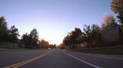 POV point of view - Driving on urban street during the sunset hour. Stock Footage