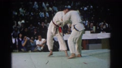 1966: two men competing in karate match as a crowd watches WEST COVINA Stock Footage