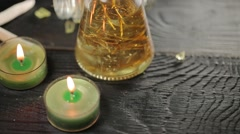 Green candles in spa salon and and massage oil Stock Footage