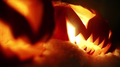 Halloween pumpkins in the winter snowy night with overflying ghost. Looped Stock Footage