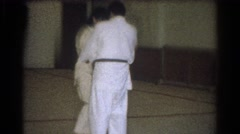 1966: the master of karate rendering training to the disciple WEST COVINA Stock Footage