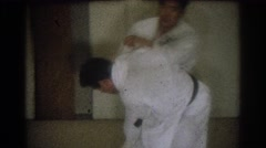 1966: men who practice a martial art in the gym WEST COVINA CALIFORNIA Stock Footage
