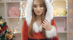Happy woman dressed in snow-maiden suit showing Chirstmas toy in 4K Stock Footage