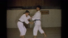 1966: learning takedowns in a karate dojo. WEST COVINA CALIFORNIA Stock Footage