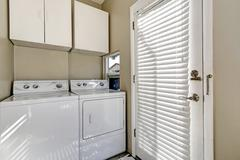 Small and simple laundry room with old-fashioned appliances. Northwest, USA Stock Photos