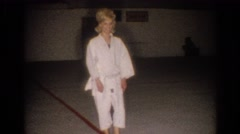 1967: female karate student in gai and cat. LOS ANGELES CALIFORNIA Stock Footage