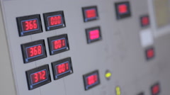 Industrial control panel with red digits on the display showing parameters Stock Footage