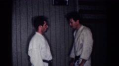 1967: two men practicing martial arts LOS ANGELES CALIFORNIA Stock Footage